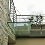 Coperture e Pensiline in vetro vista laterale - Castel Romano - Centro Commerciale - VetroeXpert - Coperture e Pensiline