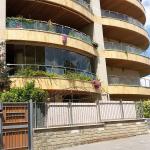 Coperture balconi circolari vista frontale - Roma - VetroeXpert - Vetrate Pieghevoli e vetrate a scomparsa Glassroom