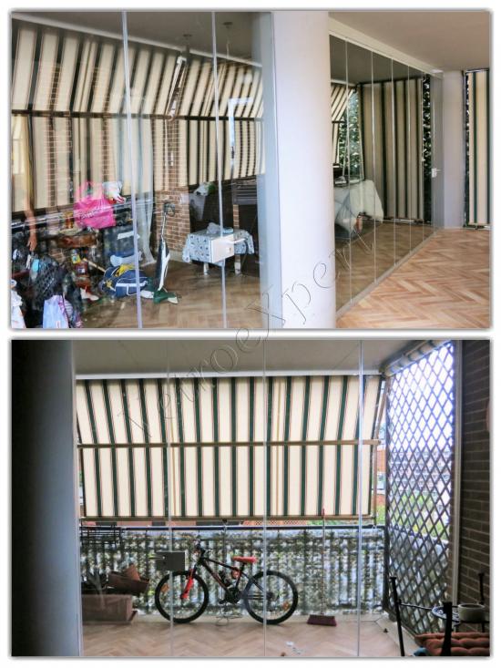 Vetrata pieghevole chiusa uscita balcone vista frontale - Roma - VetroeXpert - Vetrate Pieghevoli e vetrate a scomparsa Glassroom