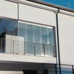 Vetrate a scomparsa Glassroom coperture balconi vista laterale - Roma - VetroeXpert - Vetrate Pieghevoli e vetrate a scomparsa Glassroom