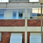 Vetrate pieghevoli per balconi vista dal basso - Roma - VetroeXpert - Vetrate Pieghevoli e vetrate a scomparsa Glassroom