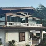 Vista latera e di insieme Vetrate Glassroom copertura balcone - Roma - VetroeXpert - Vetrate Pieghevoli e vetrate a scomparsa Glassroom