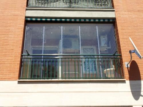 chiudere un balcone senza permessi